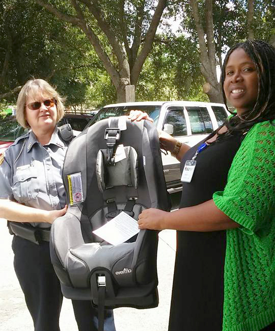 Success By 6 Coordinator Chrissy Vickers Helps Load Up Car Booster Seats Donated To The Ocala Police Department